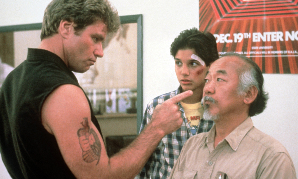 Ralph Macchio, Pat Morita, and Martin Kove in The Karate Kid (1984)