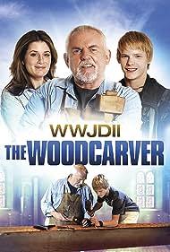 John Ratzenberger, Nicole Oliver, and Dakota Daulby in The Woodcarver (2012)