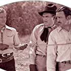 Gene Austin, Karl Hackett, and Charles King in Songs and Saddles (1938)