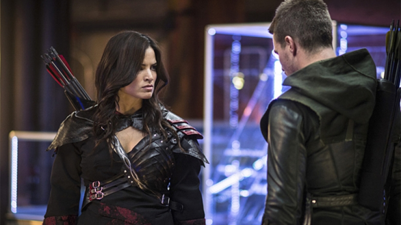 Katrina Law and Stephen Amell in Arrow (2012)