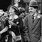 Charles Chaplin, Alice Howell, Mabel Normand, and Helen Carruthers in Mabel's Busy Day (1914)