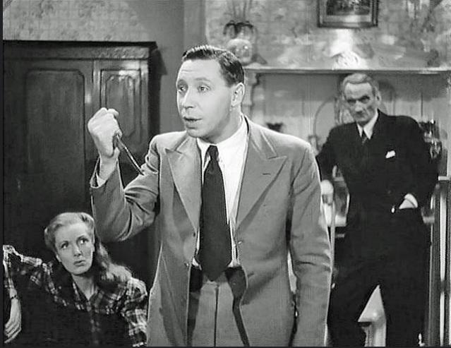 Georgina Cookson, George Formby, and Carl Jaffe in I Didn't Do It (1945)