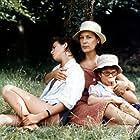 Charlotte Gainsbourg, Julie Glenn, and Bernadette Lafont in L'effrontée (1985)