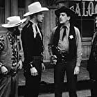 Ted Adams, Buster Crabbe, Malcolm 'Bud' McTaggart, and Al St. John in Billy the Kid Trapped (1942)