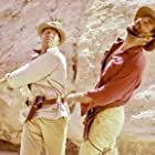 George Kennedy and Nigel Green in The Pink Jungle (1968)