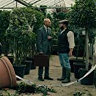 Luke Goss and Ross O'Hennessy in The Loss Adjuster (2020)