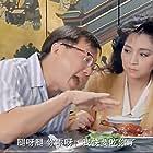 Michael Hui and Paula Tsui in Gai tung ngap gong (1988)