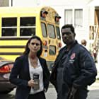 Melissa Ponzio and Eamonn Walker in Chicago Fire (2012)