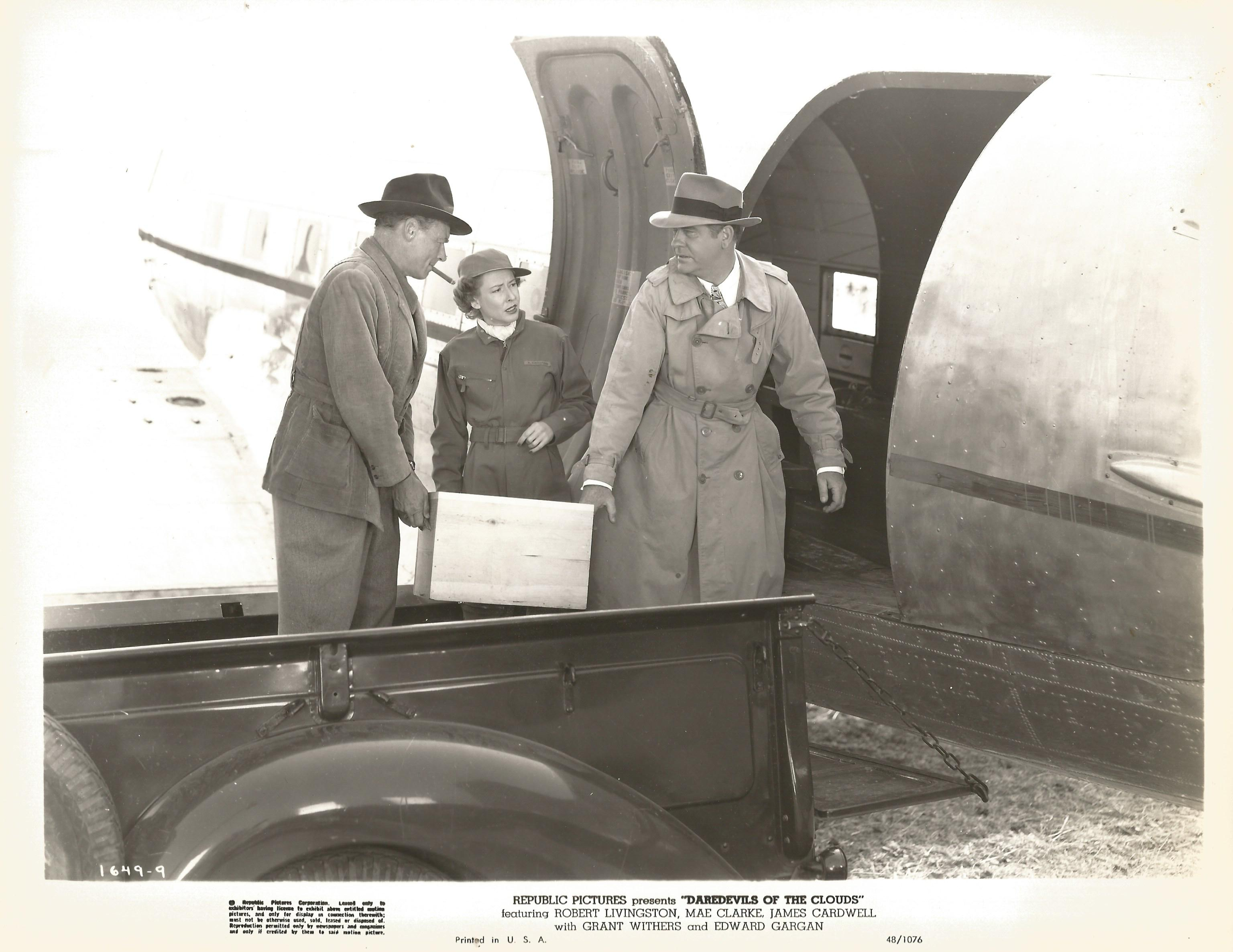 James Cardwell, Mae Clarke, and Edward Gargan in Daredevils of the Clouds (1948)