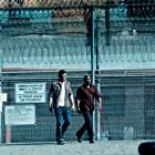 Josh Duhamel and Bokeem Woodbine in Unsolved (2018)