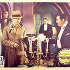 Ronald Colman, Arthur Hohl, Warner Oland, and George Regas in Bulldog Drummond Strikes Back (1934)