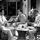Humphrey Bogart, E.E. Clive, and Donald Woods in Isle of Fury (1936)