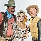 Kirk Douglas, John Wayne, and Joanna Barnes in The War Wagon (1967)