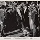 Randolph Scott, Harlan Briggs, Harry Hayden, Jack Kenny, Kathryn Sheldon, Charles Stevens, and Blackie Whiteford in Frontier Marshal (1939)