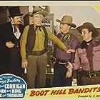 Budd Buster, Steve Clark, John 'Dusty' King, and Max Terhune in Boot Hill Bandits (1942)
