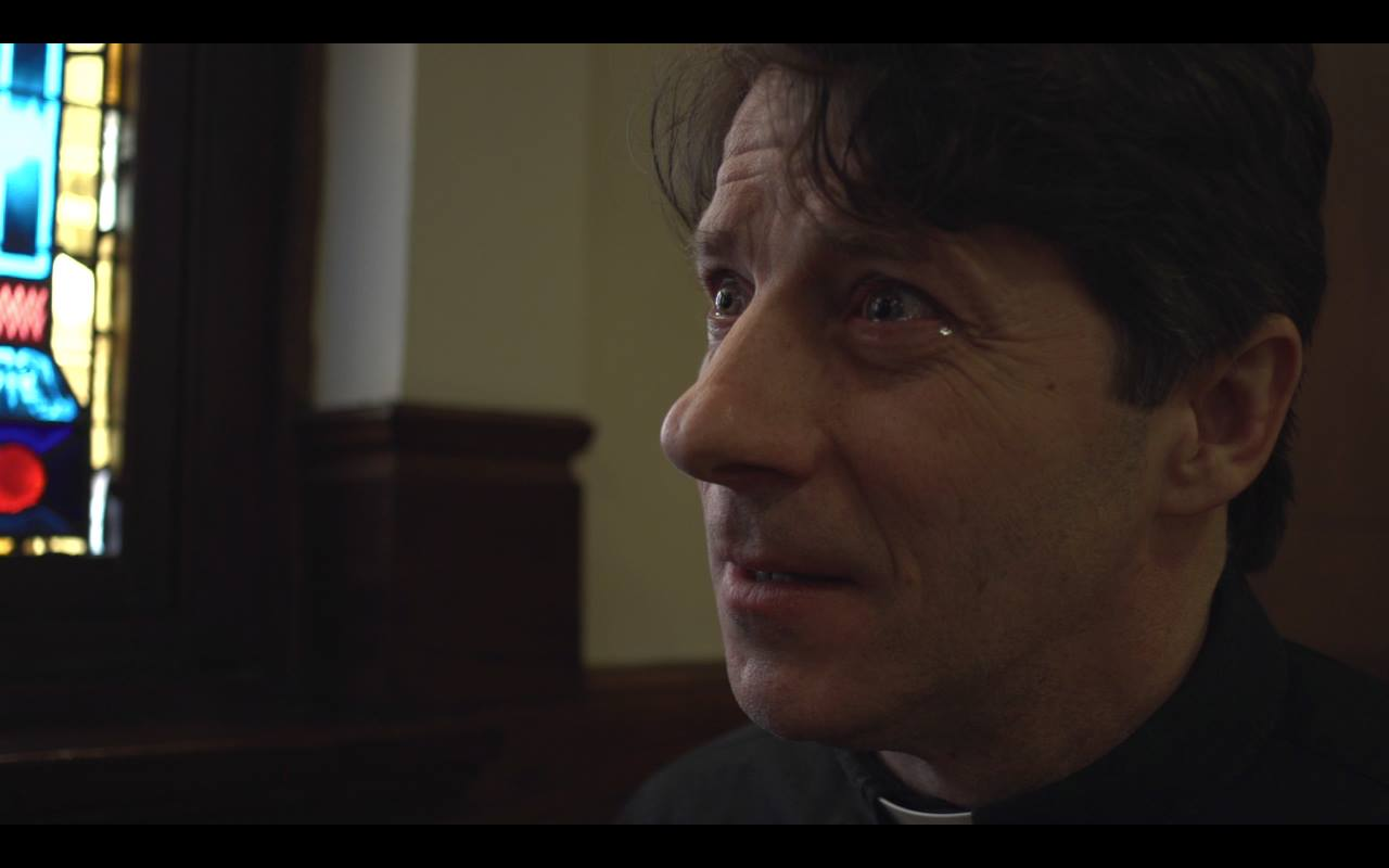 """Grant Neale as Father Joe. Photo Grab from the film """"Bless Me."""""""