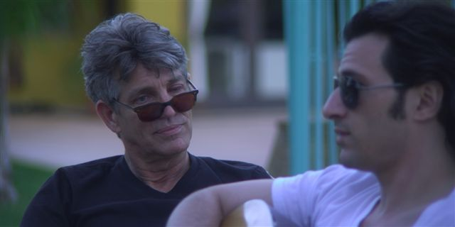 Eric Roberts and Hal Ozsan in Groupie (2010)