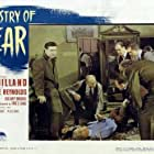 Ray Milland, Dan Duryea, and Percy Waram in Ministry of Fear (1944)