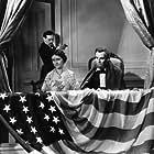 Kay Hammond, Walter Huston, and Ian Keith in Abraham Lincoln (1930)
