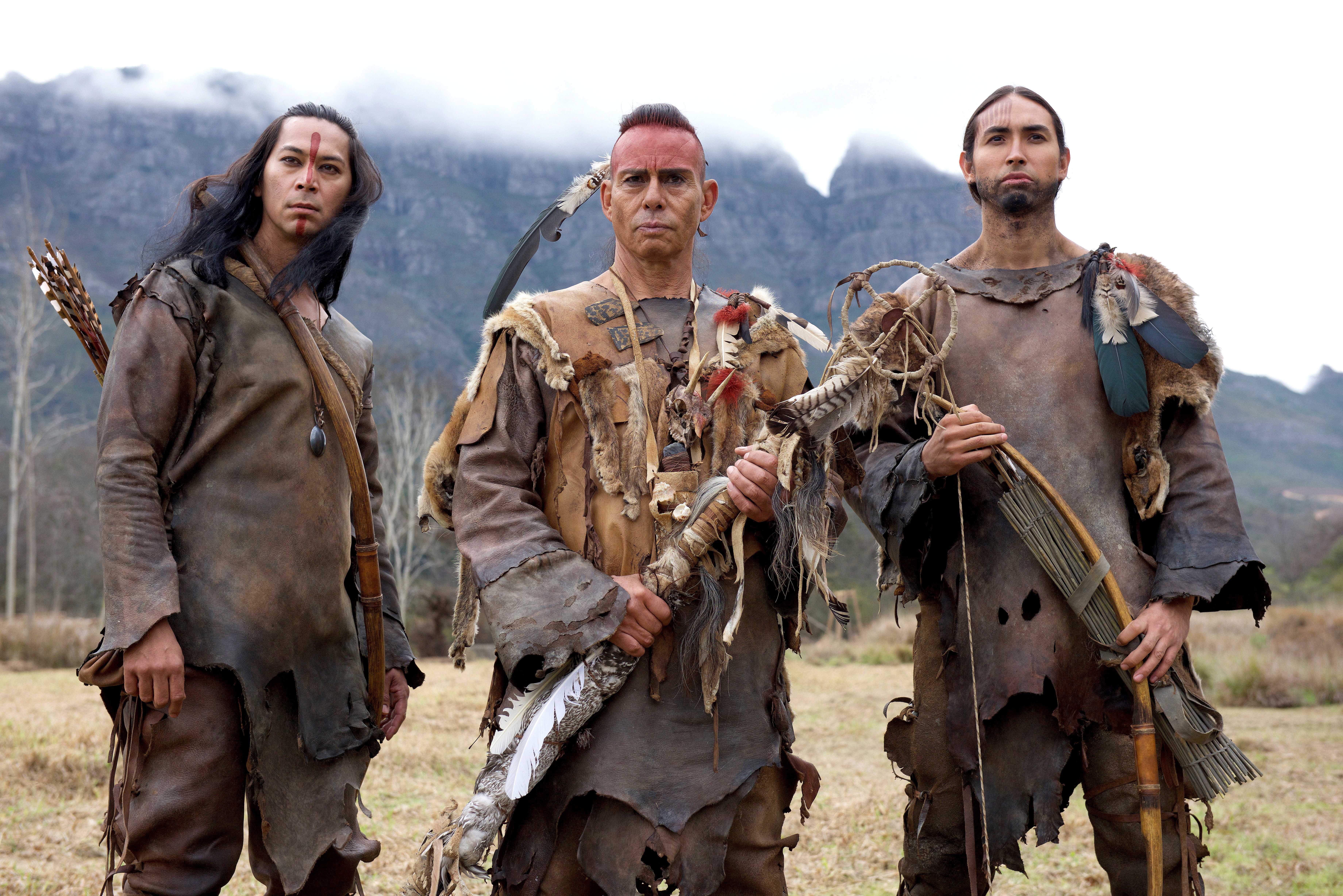 on the set of Saints & Strangers Squanto (Kalani Queypo), Massasoit (Raoul Trujillo), Hobbamock (Tatanka Means)