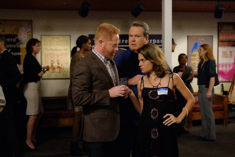 Jesse Tyler Ferguson, Eric Stonestreet, and Paula Christensen in Modern Family (2009)