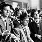 Richard Widmark, Donald Buka, Vincent Donahue, and Phillip Pine in The Street with No Name (1948)