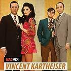 Jon Hamm, Vincent Kartheiser, Jessica Paré, and Rich Sommer in Mad Men (2007)