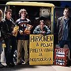 Unto Helo, Jimi Pääkallo, Timo Lavikainen, Pekka Valkeejärvi, and Mikko Leppilampi in Helmiä ja sikoja (2003)