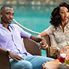 Jay Pharoah and Christiani Pitts in Resort to Love (2021)