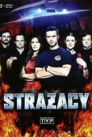 Olaf Lubaszenko, Dawid Zawadzki, Maciej Zakoscielny, Weronika Rosati, Michal Zurawski, and Marta Scislowicz in Strazacy (2015)