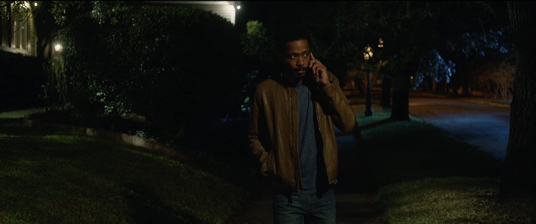 Andre King (Lakeith Stanfield) lost in the 'burbs in Get Out (2017)