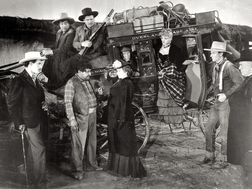 John Wayne John Carradine George Bancroft Berton Churchill Andy Devine Donald Meek Thomas Mitchell Louise Platt and Claire Trevor in Stagecoach 1939