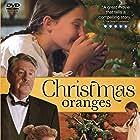 Edward Herrmann, Nancy Stafford, and Bailee Michelle Johnson in Christmas Oranges (2012)