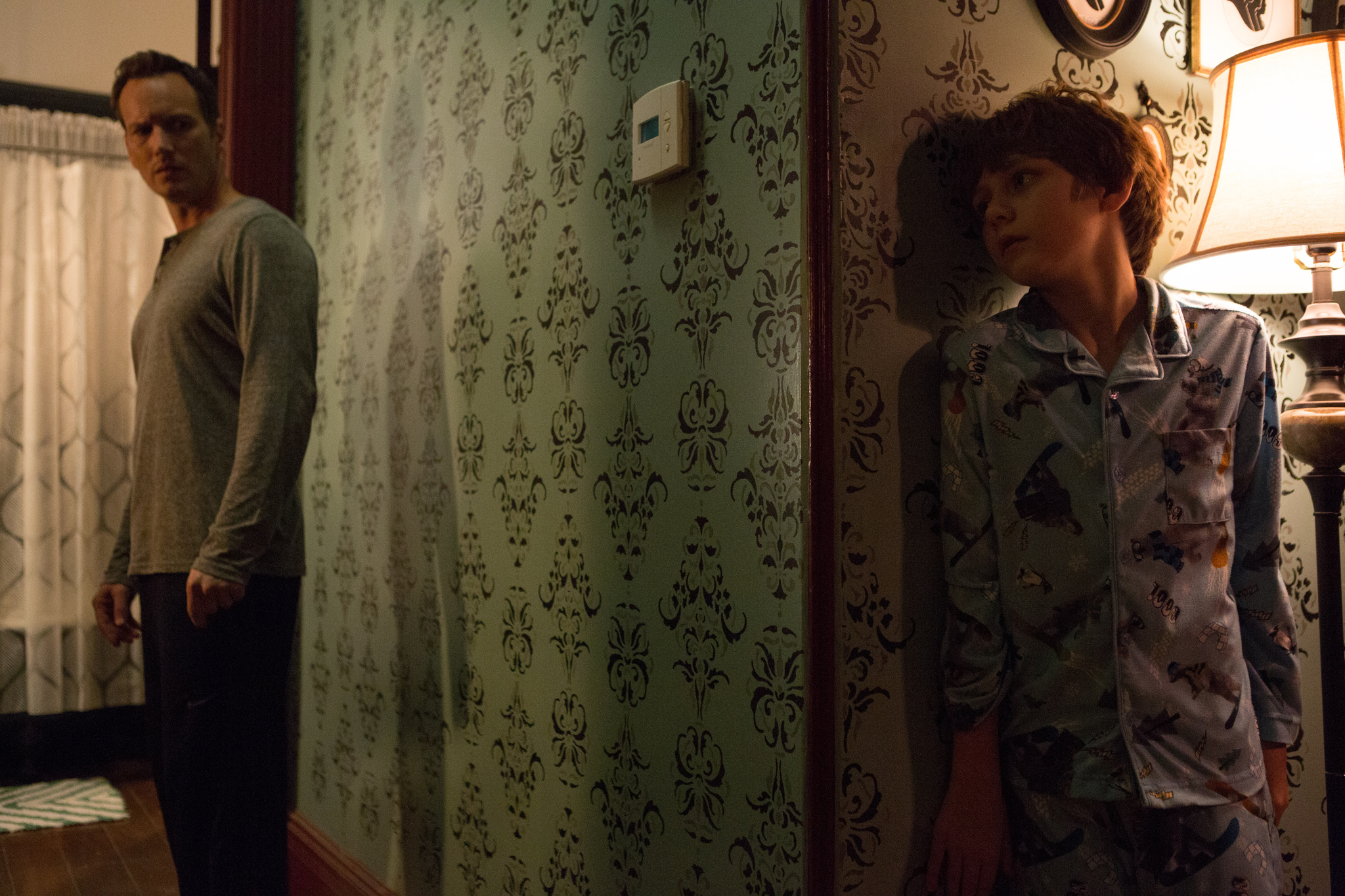 Patrick Wilson and Ty Simpkins in Insidious: Chapter 2 (2013)