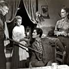 John Drew Barrymore, Lois Butler, Kristine Miller, and Basil Ruysdael in High Lonesome (1950)
