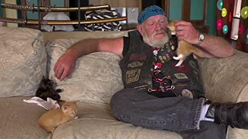 A contemplative portrait of Ron 'Stray Dog' Hall: biker, Vietnam Vet, and lover of small dogs.
