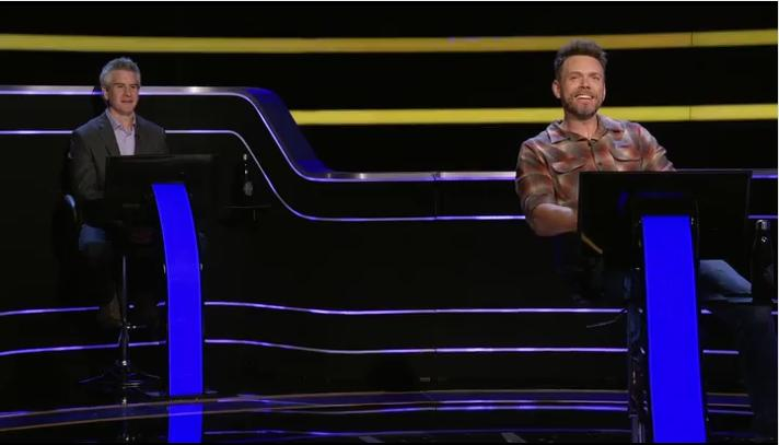 Joel McHale in Who Wants to Be a Millionaire (2002)