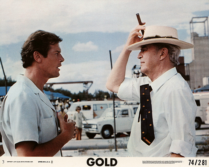 Roger Moore and Ray Milland in Gold (1974)