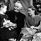 Bette Davis, Marlene Burnett, and Donald Crisp in The Old Maid (1939)