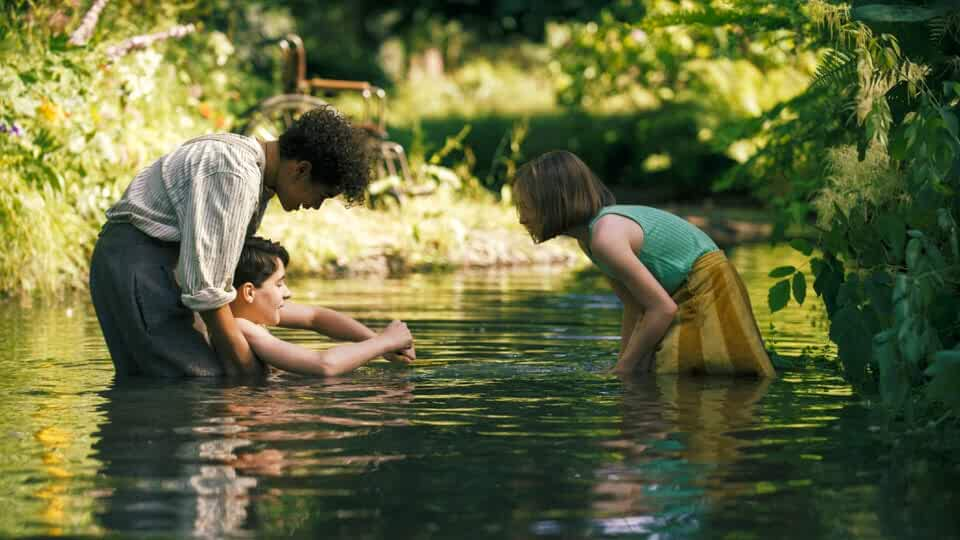 Dixie Egerickx, Edan Hayhurst, and Amir Wilson in The Secret Garden (2020)