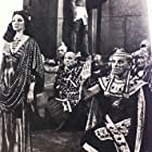 Joan Collins and Alexis Minotis in Land of the Pharaohs (1955)