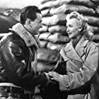 Carole Landis and John Harvey in Four Jills in a Jeep (1944)