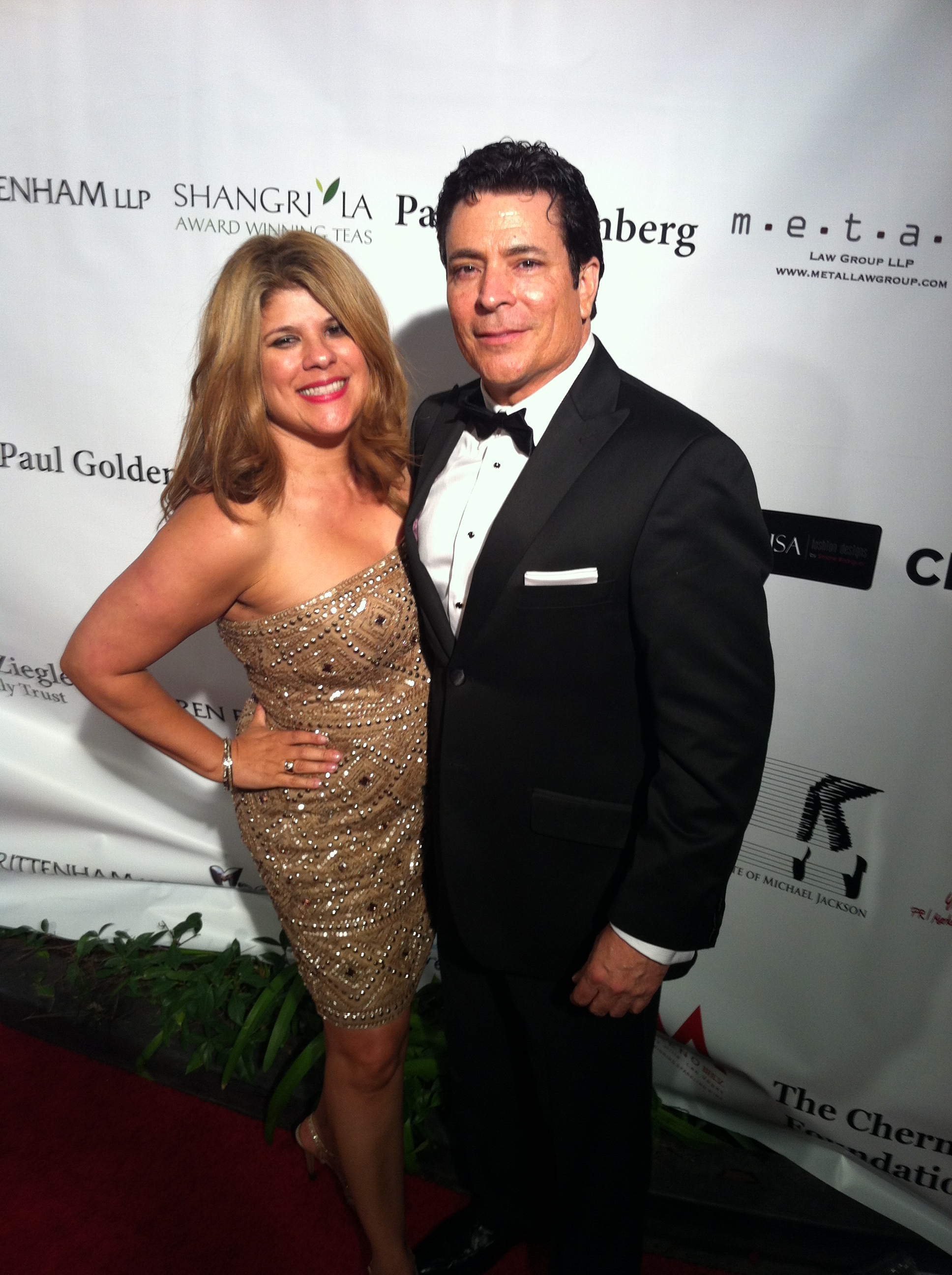 Writer/Director Daniel R. Chavez with publicist Yvette Morales of YM & Associates on Red Carpet at Children Uniting Nations Oscar after party in Beverly Hills,CA