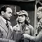 Edward G. Robinson, Jane Bryan, and Ruth Donnelly in A Slight Case of Murder (1938)