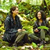 Jennifer Lawrence and Amandla Stenberg in The Hunger Games (2012)