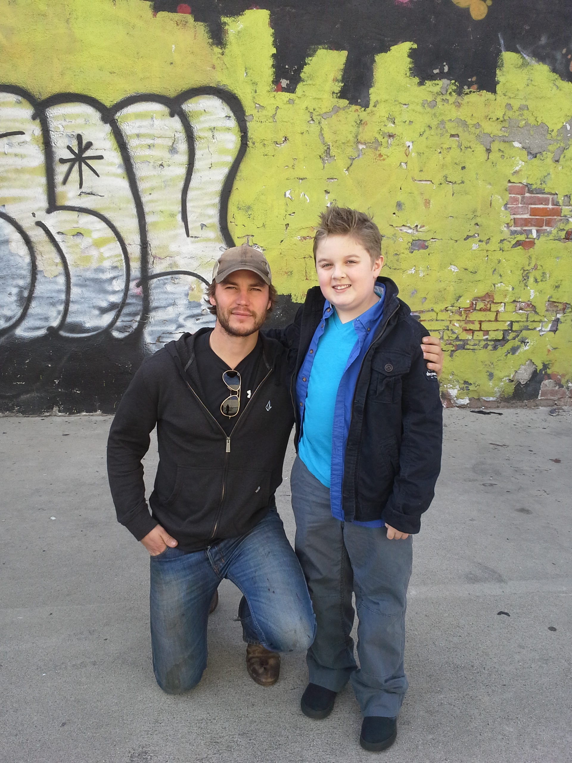 """Brice Fisher with Taylor Kitsch working on the set of """"Pieces"""" directed by Taylor Kitsch."""