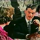 Derek Blomfield and Viola Keats in Escort for Hire (1960)