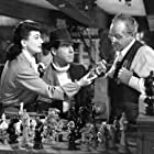 Joan Crawford, Steven Geray, and Fred MacMurray in Above Suspicion (1943)