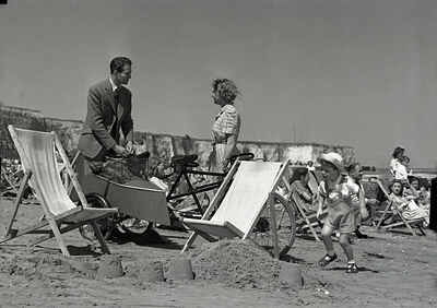 """Derek Bond, Joan Hopkins and Barrie Smith (son of producer Herbert Smith)  on the beach at Cliftonville Margate, Kent, England, for """"The Weaker Sex"""""""