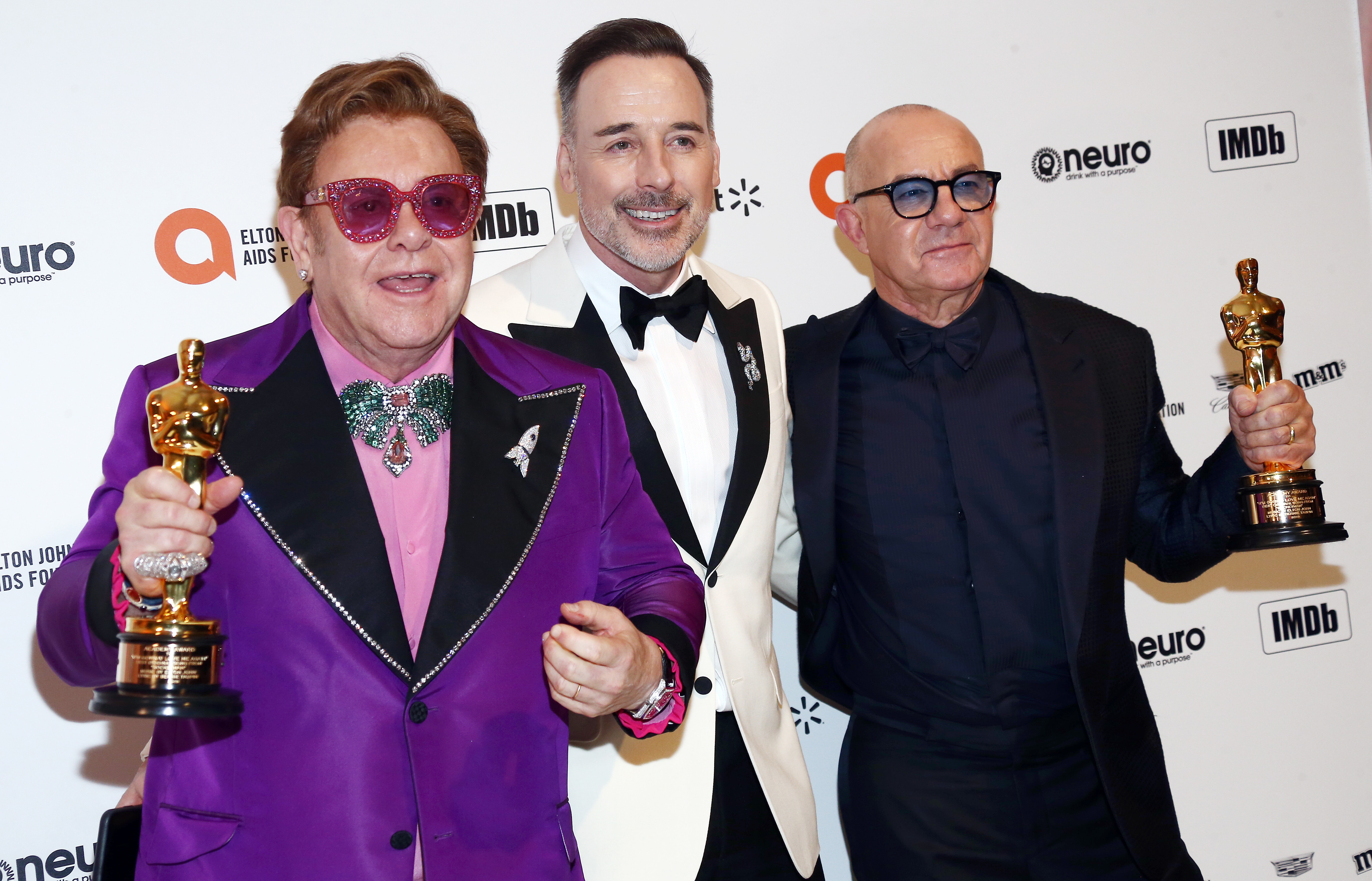 Elton John, Bernie Taupin, and David Furnish